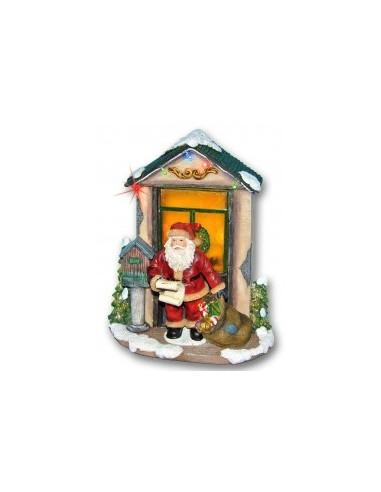 Verlicht huis met kerstman